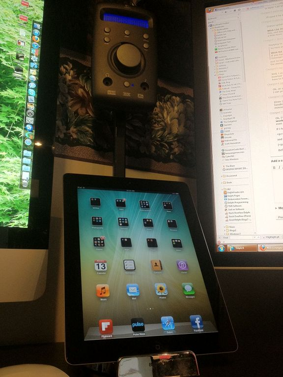 the ipad2 sits in a belkin stand and above that you can see the logitech z 680 sound system controller that ive mounted on an old monitor stand that i belkin office